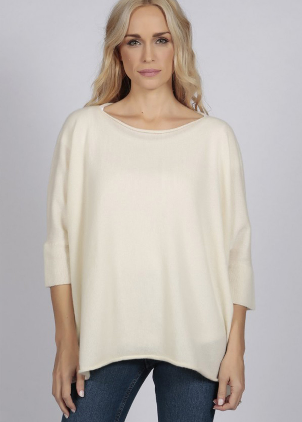 Cream cashmere sweater with jeans width=